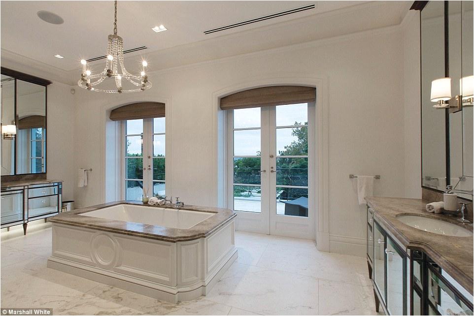 A bath view tub rainforest Versace inspired room size city apartments luxurious bathrooms Australian property market