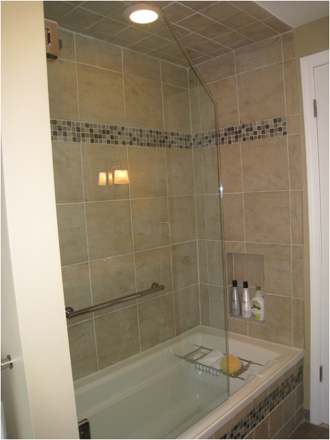 Bathtubs soaking 4 3 4 Frameless Tub Shower Door with Dark Cabinets