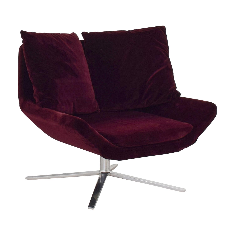 ligne roset ligne roset burgundy velvet swivel chair
