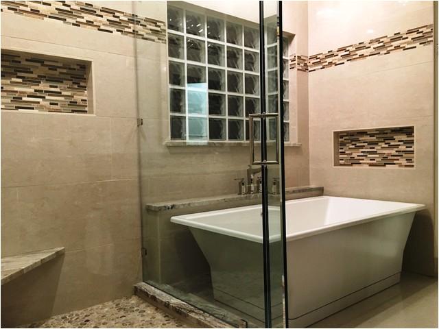 MASTER BATHROOM Free Standing Tub Crema Marfil Tile White Reef Granite contemporary bathroom austin