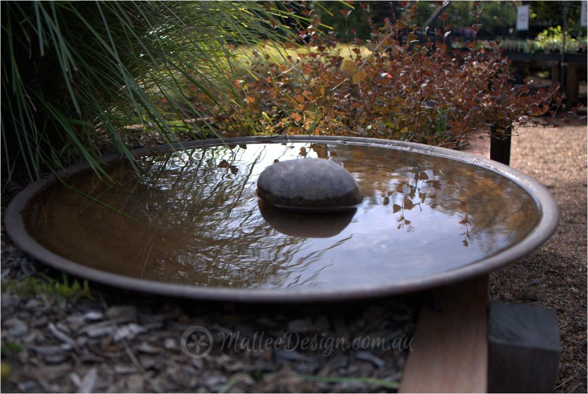 mallee spun copper bird baths and water bowls on display at sydney wildflower nursery