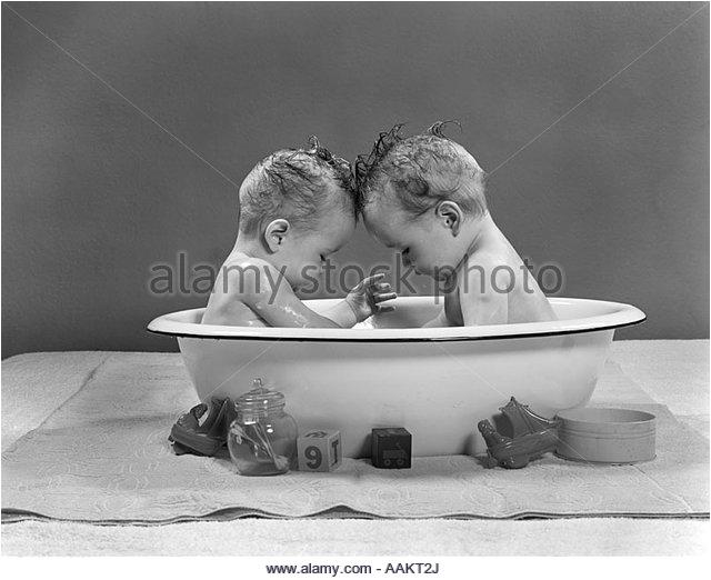 children bathing boy girl tub