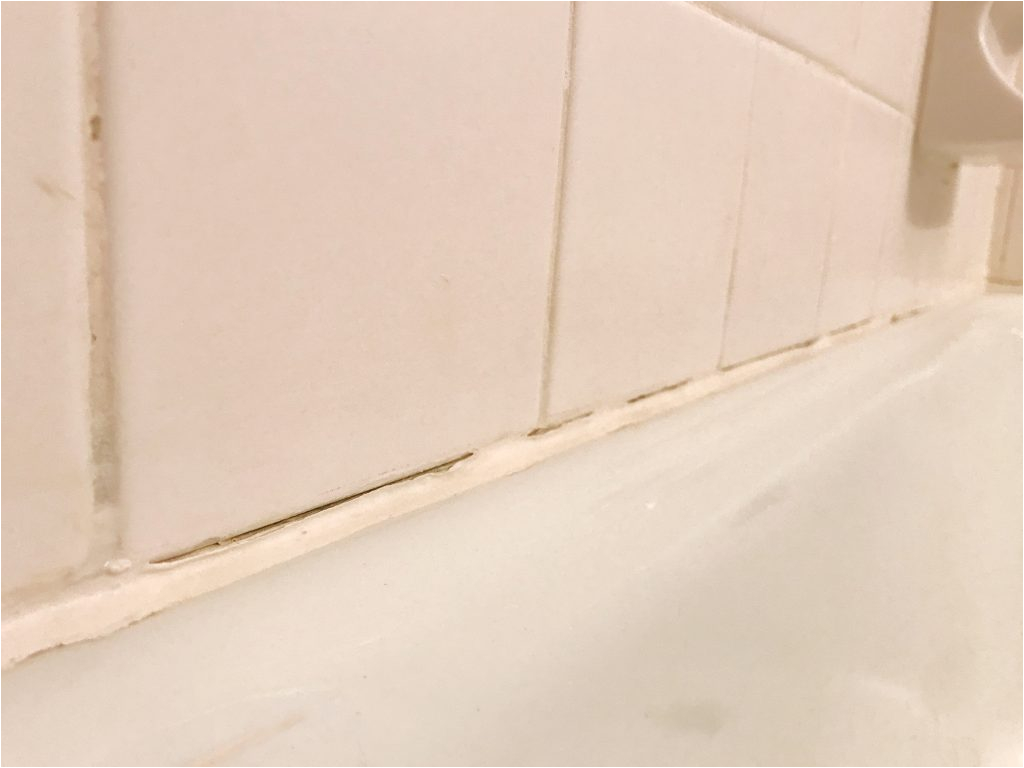 replace old caulk bathtub