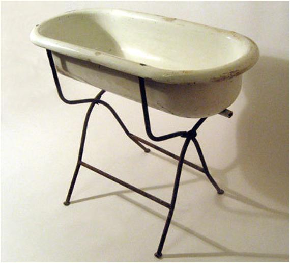 vintage porcelain baby bath planter with