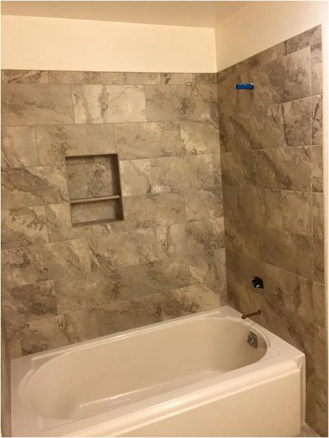 Tile Vs Tub Surround Tub Surround Vs Tile How to Install Handicap Grab Bars In