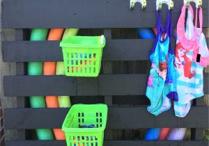 Diy Pool Float Rack Diy Pool toys Storage Painted Pallet Dollar Store Baskets and Hooks