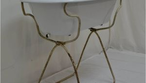 Enamel Baby Bathtub Vintage Porcelain Enamel Baby Bath On Folding Stand at 1stdibs