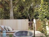 Freestanding Bathtub Garden A Serene Outdoor Bathing area Features A Barcelona Tub by