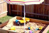 Kidkraft Backyard Sandbox 00130 Use Beach Umbrella to Provide Shade Over the Sandbox to Secure Use