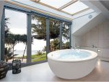 Small Bathtubs Australia Make A Splash Into Your Bathroom with Floor to Ceiling Windows