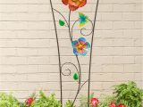 Spinning Garden Art Our Spinning Flower Garden Trellis Does Double Duty as Plant Support