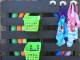 Standing Pool Float Rack Diy Pool toys Storage Painted Pallet Dollar Store Baskets and Hooks