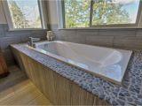What is A Garden Bathtub Rock Pebble Surround with Garden Tub