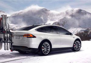 Yakima Tesla Roof Rack Tesla Model X Shown with Ski Snowboard Carrying Hitch Rack